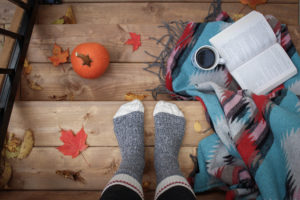 cozy socks embrace fall weather with pumpkins and coffee